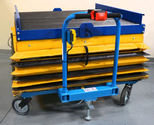 lift safer with a Custom Motorized Scissor Lift Cart With Conveyor and Safety Skirting