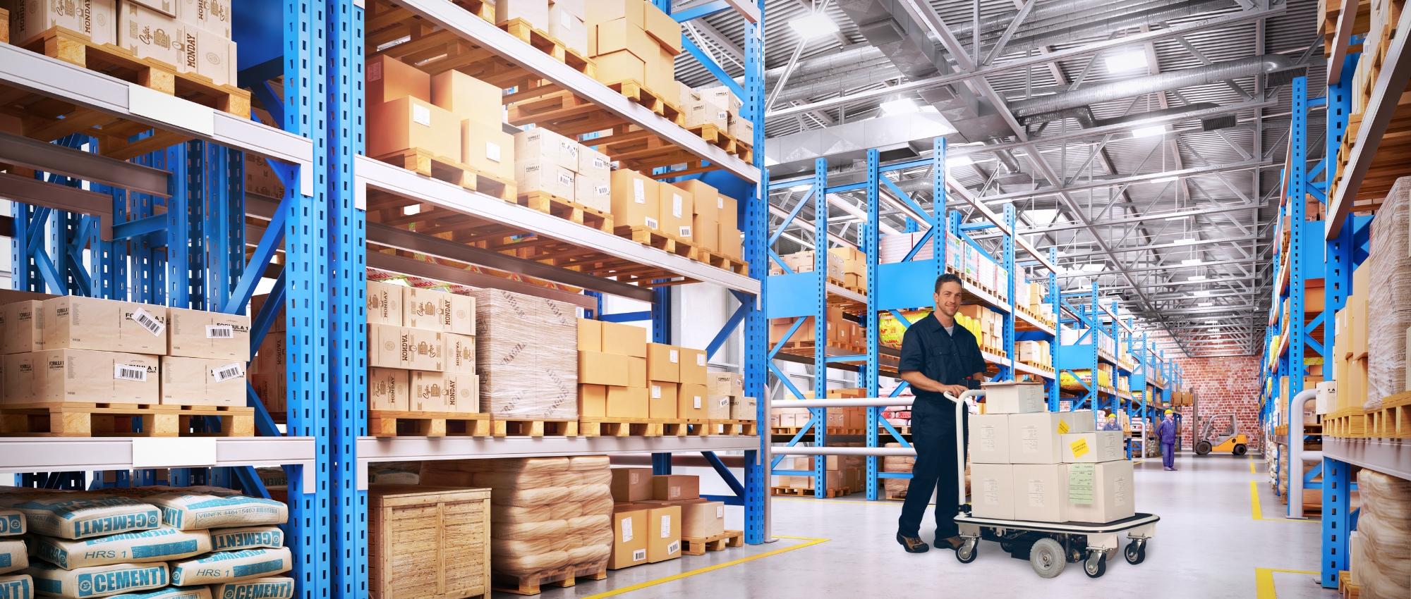 Manufacturing Worker Pushing Motorized Platform Cart